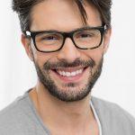 Closeup of smiling man wearing spectacle